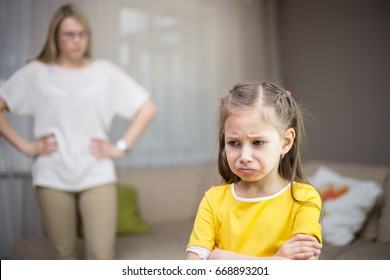 Mother scolds her daughter. Family relationships. The education of the child.