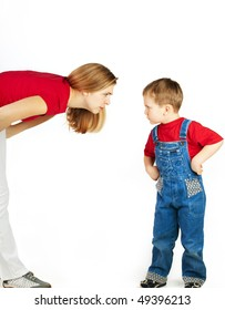 Mother scolds her son on white background