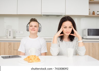 Mother screaming to her son while he listening music and doesn't listen
