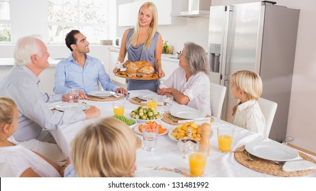 Mother serving the turkey for thanksgiving
