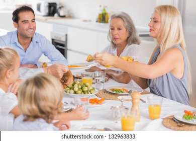 Mother serving vegetables to her family