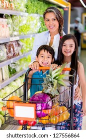 Mother shopping at the supermarket with her kids