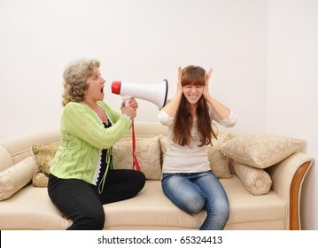 mother shouting at her daughter with a megaphone