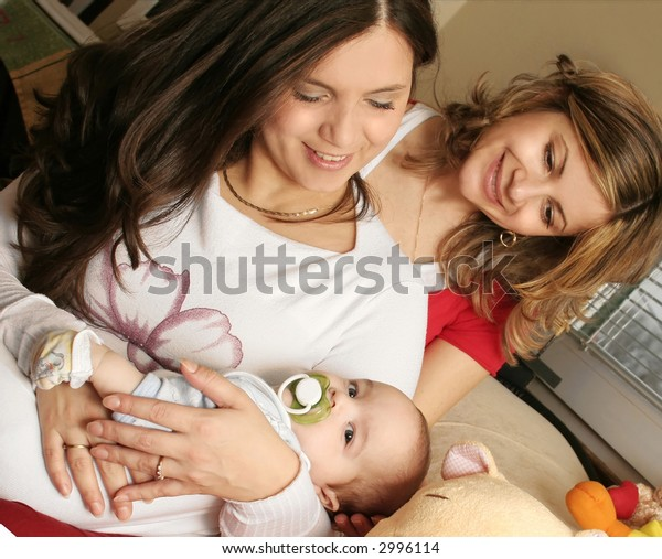 Mother and sister with baby