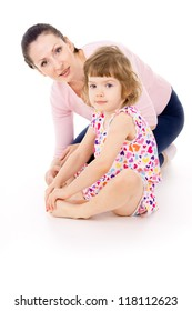 mother sits with little beautiful girl isolated on white background