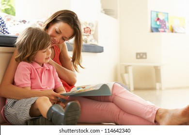 Mother Sitting With Son Reading Story Indoors