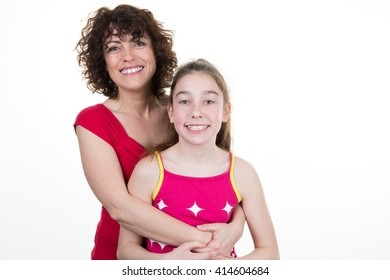 Mother smiling and hugging her daughter isolated