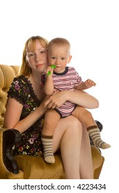 the mother with son in armchair on white background