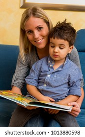 mother and son with a book