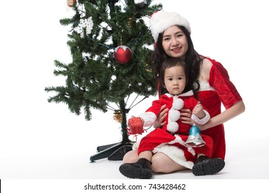Mother and son with Christmas attire playful on white background. Holiday Christmas Concepts.