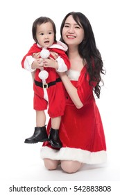 Mother and son with christmas costume playful on white background.