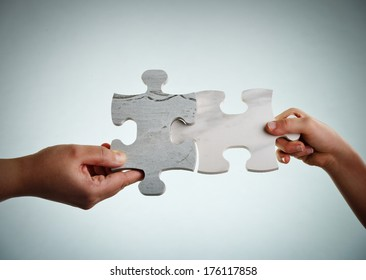 Mother and son connecting the jigsaw puzzle