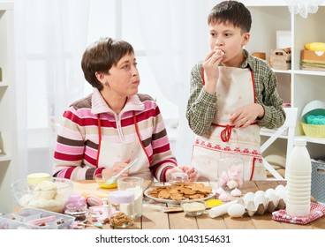Mother and son cooking at home. Healthy food concept