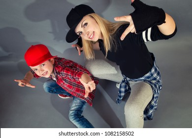 Mother and son dance hip-hop.Urban lifestyle. Hip-hop generation.
