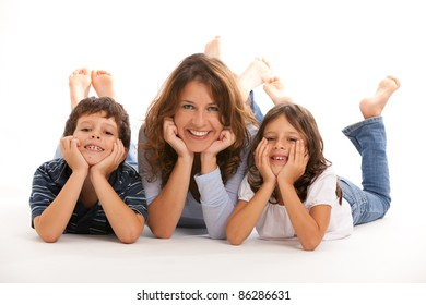 Mother, son and daughter with hands on face having fun on a white background.