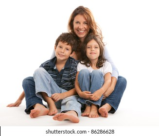 Mother, son and daughter in a happy embrace on a white background.