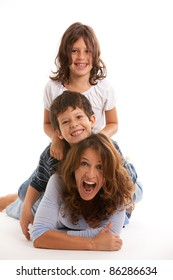 Mother, son and daughter having fun on a white background.