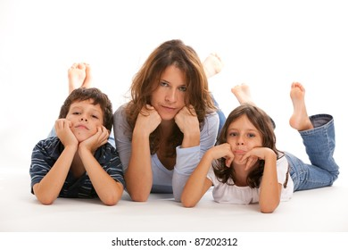 Mother, son and daughter with a sad expression on a white background.
