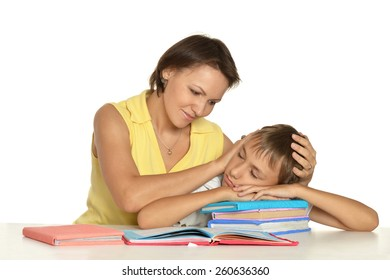 Mother and son doing homework together on a white background