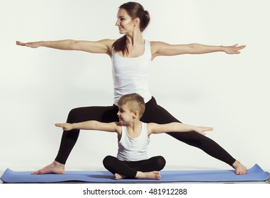 mother and son doing yoga (sports exercises), have fun and spend a good time together . isolated on white. the concept of a healthy lifestyle
