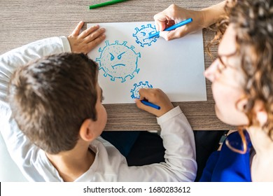 Mother and son drawing a Coronavirus