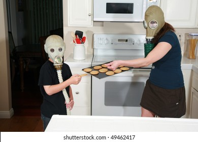 a mother and son enjoy hot fresh baked cookies in their kitchen while wearing gas masks in a post nuclear future