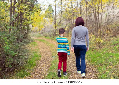 Mother and son enjoying autumn