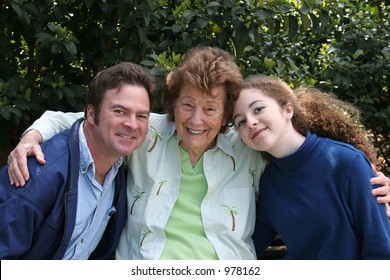 A mother, son and granddaughter enjoying time together in the park.