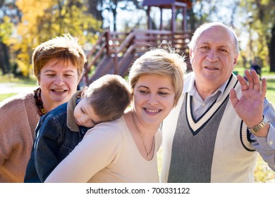 mother, son and grandparents in a park