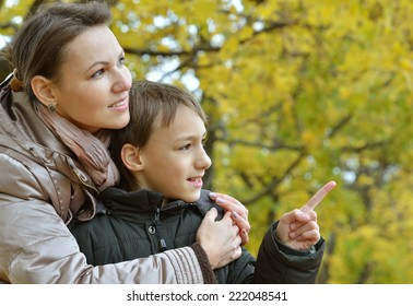 Mother and son have a walk in the autumn park