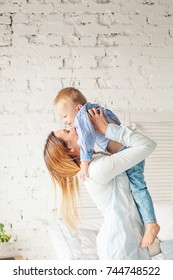Mother and Son Having Fun at Home. Mother and Child Hugging