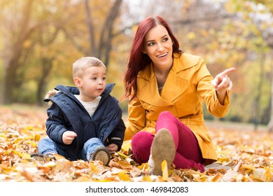 Mother and son having good time in a park, familt concept
