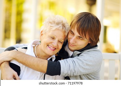 Mother and son having a hug