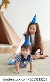Mother and son having little party at home
