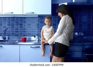 a mother with son in kitchen