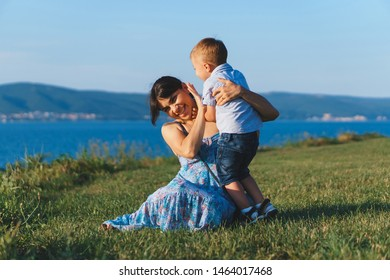 mother and son laughing and having fun in sunset light