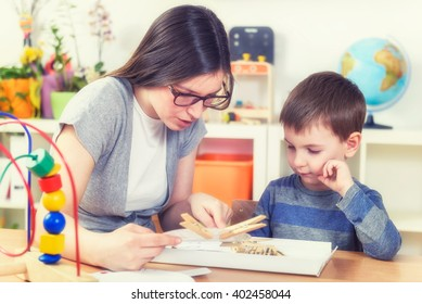 Mother and Son Learning Together at Home