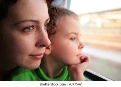 mother and son look in train`s window