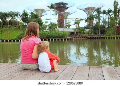 mother and son looking at gardens by the bay