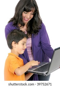 Mother and son looking and using laptop
