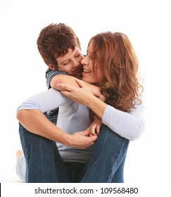 Mother and son in a loving pose isolated on a white background.