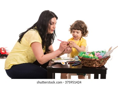 Mother and son making Easter decorations  in their home