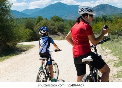 Mother and son mountain biking