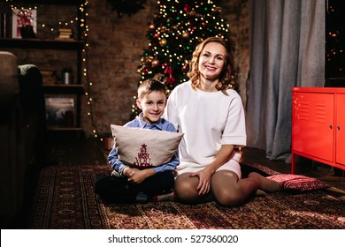 Mother and son on a background of the Christmas tree