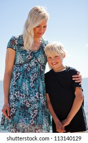 Mother and son on the beach on a beautiful summer day