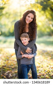 Mother and son outside in fall leaves
