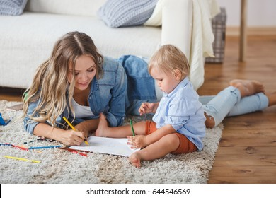 Mother and son paint the walls and floor. Children's creativity.
