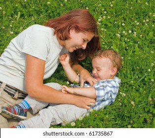 Mother and son in park