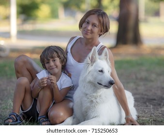 Mother and son in a park with a dog