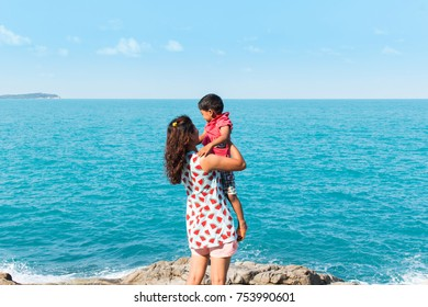 Mother and son play at sea